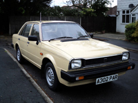 327 1984 triumph acclaim hl trio auto beige icon